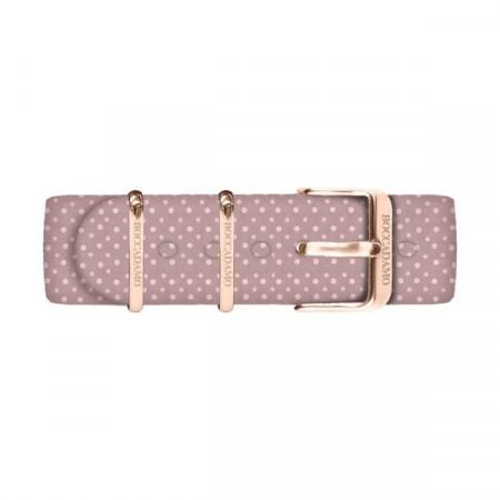 Cinturino di cotone a pois bianchi su fondo rosa