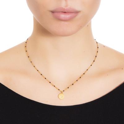 Collana dorata con elementi smaltati di nero e zircone