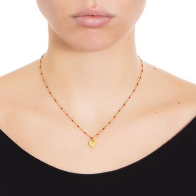 Collana dorata con elementi smaltati di rosso e zircone