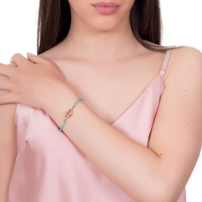 Bracciale rosato con cristalli verdi e conchiglia