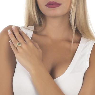 Anello con cristallo briolette chrysolite e zirconi