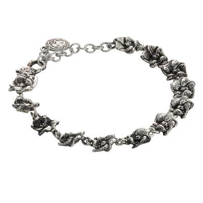 Bracciale in argento brunito con fiori di ciliegio