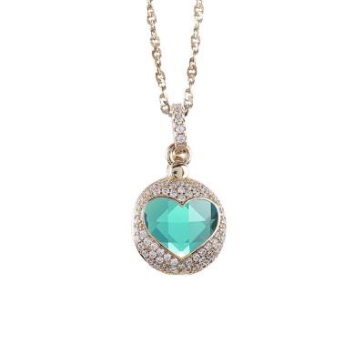 Collana color oro con cuore di zirconi apribile e cristallo verde chiaro