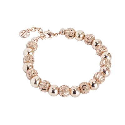 Bracciale con perle rosate e diamantate dall'effetto a onda