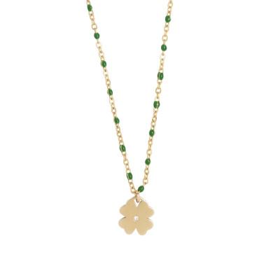 Collana dorata con elementi smaltati verde smeraldo e zircone