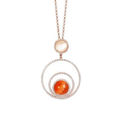 Collana con cerchi concentrici di zirconi e cabochon beige e arancione gatteggiante