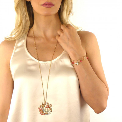 Yellow gold plated bracelet with coral colored pendants