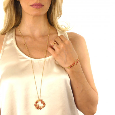 Yellow gold-plated necklace with coral-colored starfish