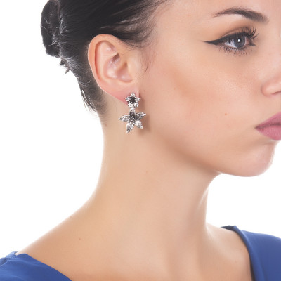 Earrings with lilium flower pendant in burnished silver
