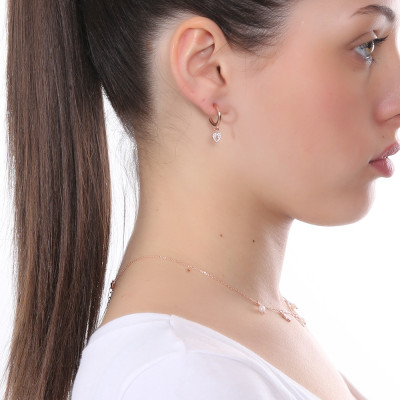 Rose gold plated half moon earring with cubic zirconia heart