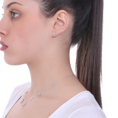Lobe earring with Latin cross of zircons