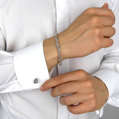 Round cufflinks with knot