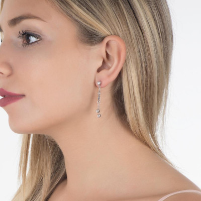 Earrings with sprigs of zircons in the heart