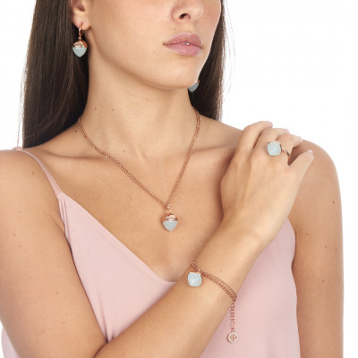 Rose gold plated ring with aquamarine crystal pendant