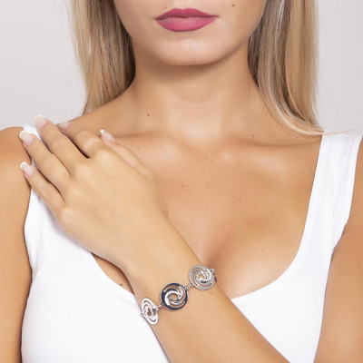 The semirigid Bracelet with decorations of vortex and zircons