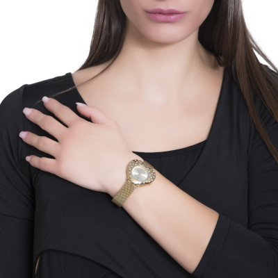 Gold watch with heart-shaped dial and Swarovski crystals in rain