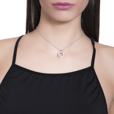 Necklace with bicolor pendant with smooth intertwined circles and zircons