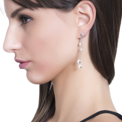 Earrings with a double pendant of Swarovski pearls and zircon elements