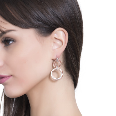 Pink gold-plated earrings with braided pendent hoops and zircons