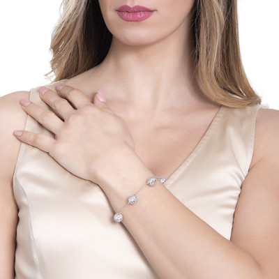 Silver bracelet with diamond spheres and zircons