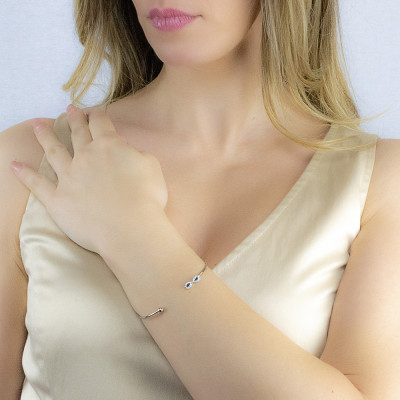 Open rigid bracelet with infinity symbol