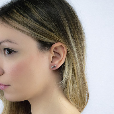 Pink lobe earrings with infinity symbol