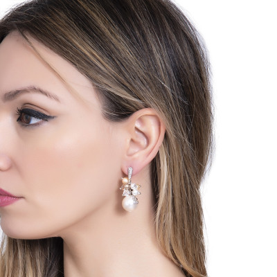 Earrings with a bouquet of cream-colored Swarovski pearls and zircons
