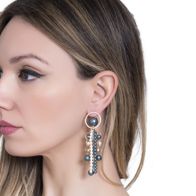 Golden earrings with strings of dangling pearls and zircons