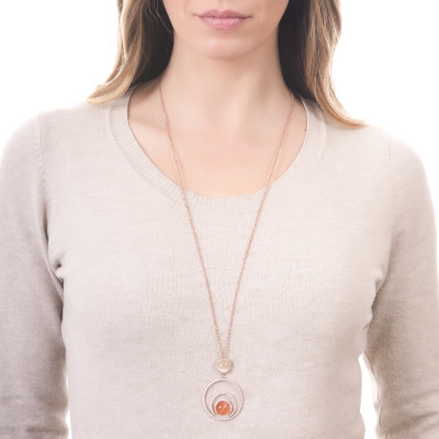 Long necklace with concentric circles of zircons and beige and orange cabochon