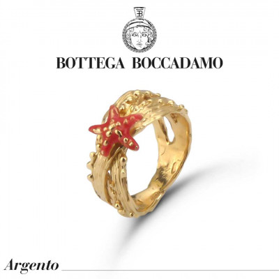 Yellow gold plated band ring with coral-colored starfish