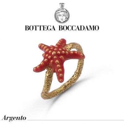 Yellow gold plated ring with coral-colored starfish