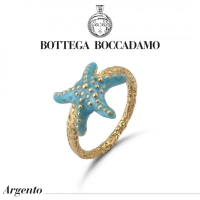Yellow gold plated ring with light blue starfish