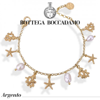 Yellow gold plated bracelet with natural pearls and charms