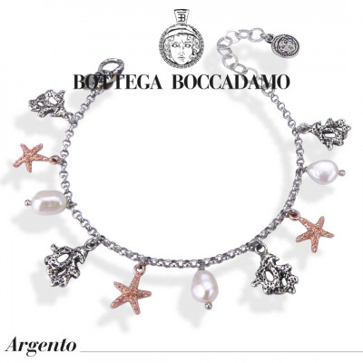 Bracelet with natural pearls and two-tone charms