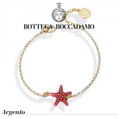 Yellow gold plated bracelet with coral-colored starfish