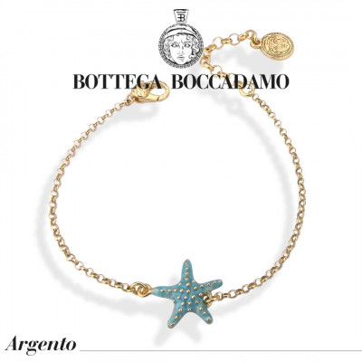 Yellow gold plated bracelet with light blue starfish