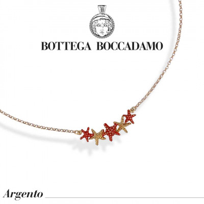 Yellow gold-plated necklace with coral-colored starfish in the center