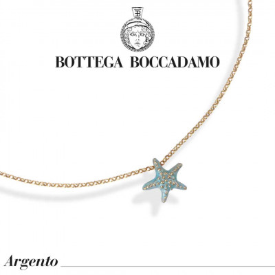 Yellow gold plated necklace with light blue starfish pendant