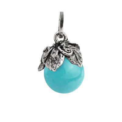 Charm with turquoise paste