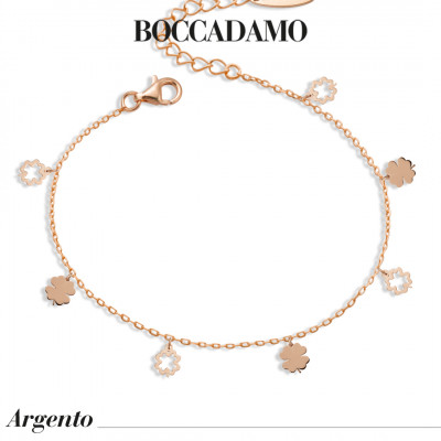 Rose gold plated bracelet with hanging shamrocks