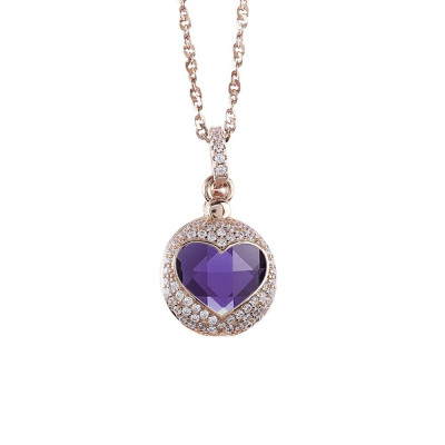 Necklace color pink gold with the heart of retractable zircons and crystal Tanzanite