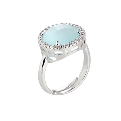 Ring with crystal aquamilk and zircons