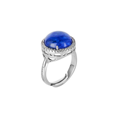 Ring with rutilated blue cabochon crystal and zircons