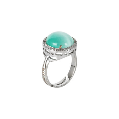 Water green cabochon crystal ring with zircons