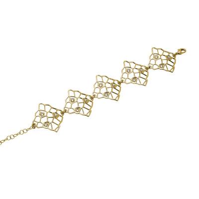 Gold bracelet with asymmetric modules and Swarovski