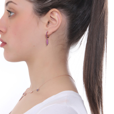 Half moon earring with lightning of fuchsia cubic zirconia