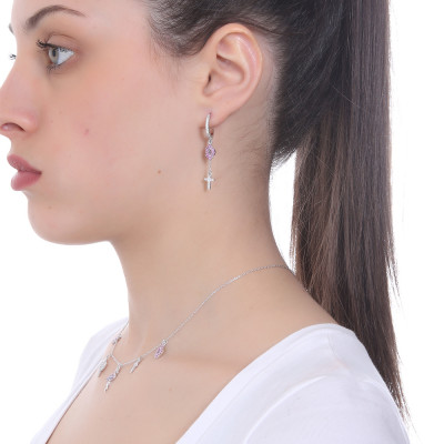 Crescent earring with mouth of fuchsia cubic zirconia and cross