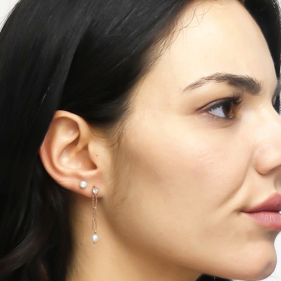 Rose gold plated stud earrings with natural pearls