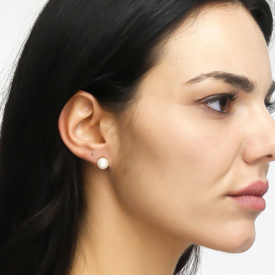 Stud earrings with large natural pearls