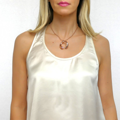 Necklace with rose quartz-colored crystals, gray cat-like agate and zircons